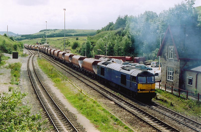 The yard driver has handed the train over to the booked driver and 6E51 1235 WO Peak Forest to Selby gets away. The Mirrlees 8MB275T 3100hp powerplant in 60044 roars away at full chat as the train of several thousand tons starts to move on the rising 1 in 90 gradient.