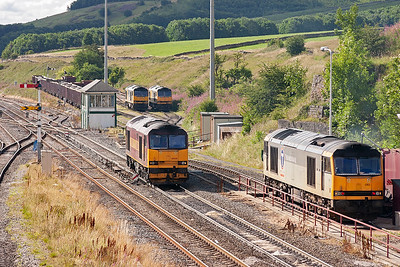 """The driver of 60500 has changed ends and now takes his loco into the up side yard.  The loco takes the turnout and passes the shunting ground signal in the """"off"""" position giving permission to pass over the turnout either straight ahead or into the yard."""