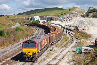 Class 66 locomotives were starting to make their presence felt at Peak Forest especially as at the time of photography, there were only about 25 class 60's in traffic. 66078 stands shut down at the head of 6H59 MWFO 1410 Peak Forest to Dowlow empty bogie boxes.
