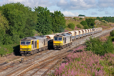 Tugs 60015 and 60061 pass in wonderful morning sunshine. A treat for myself and the other four photographers present.