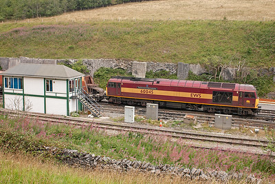 The train slowly passes in front of the refurbished former Midland Railway Peak Forest signalbox.