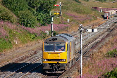 Early in the morning and 60015 creeps up to the down home signal protecting Great Rocks Junction whilst running round its train seen in the background.