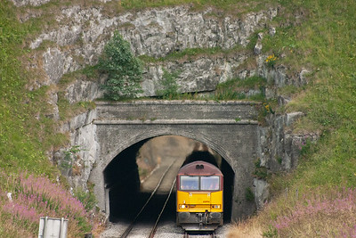 Now with its train in tow, 60094 emerges from the 161 yard long Great Rocks tunnel.