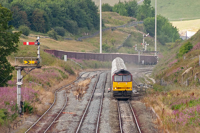 Back at Great Rocks proper and another downhill arrival gingerly approaches. 60075 is in charge of 6M82 TX 1245 Walsall to Tunstead 24 empty JGA bogie cement tanks.