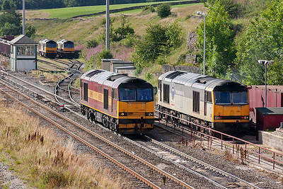 60500 has left its hoppers at Tunstead and come up to Peak Forest for stabling. It pauses beside 60061 before going to join 60015 and 60063 already parked up.