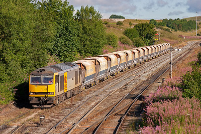 The early morning sun lights the scene to perfection as 60015 brings its 17 empty JGA hoppers down the Up and Down Through Siding. The gradient is a falling1 in 90 and the driver brings the train to a stand at the signal.