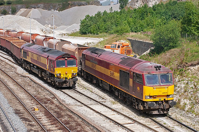 The sidings at Peak Forest are very long and 60045's train is being swallowed up as it passes 66078 shut down at the head of its train 6H59 MWFO 1410 Peak Forest to Dowlow empty bogie boxes.