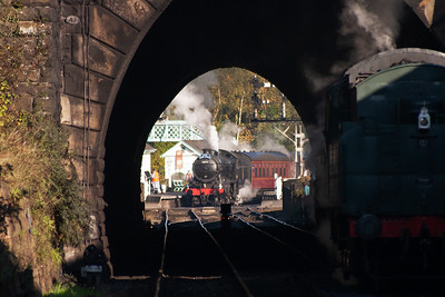 Back at the loco shed and the view to the station is made looking through the 146 yard long tunnel beneath Lease Rigg. The gates are open and Beth has the K4 blowing off ready for the hard climb to Goathland. BR Standard 4MT 80135 waits to run down to the station.