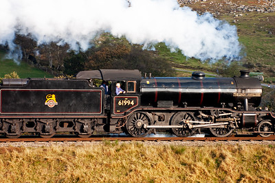 On the footplate, beside the crew, is caretaker Fraser Birrell and owner John Cameron.