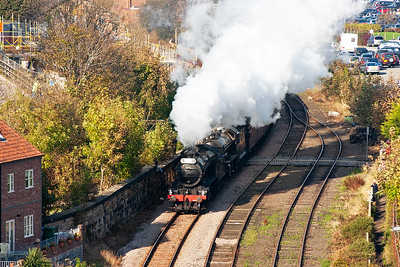 The pair of 2-6-0 locos are putting out a fine white exhaust into the cold air of this beautiful autumn afternoon as they get their train away from Whitby.
