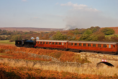 The mid afternoon sun lights the black loco and the two Gresley teak coaches perfectly as the train passes by.