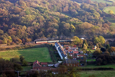 61994 and its train passes the row of cottages at Esk Valley built for ironstone miners that worked the surrounding hills. Almost half are now owned by people who work on the railway.
