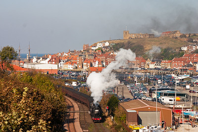 The ecs reverses slowly back into Whitby station and the locos pass over the foot crossing at Boghall. There is a photo taken on the crossing of the original railtour and an attempt to retake the shot is being made by one photographer.