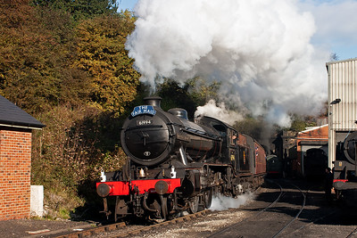 61994 clears the tunnel and takes the sharp curve past the loco shed. It carries The Fair Maid headboard.