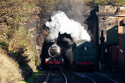 The front of 61994 breaks into the sunshine and the exhaust curls round the tunnel roof.