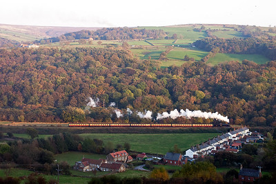 The 0-8-0 tender loco gets to grips with the 2 1/2 mile long climb at 1 in 49 to Goathland with its seven mkI coaches on the drawbar. The train passes the former miners cottages at Esk Valley. What a lovely view!