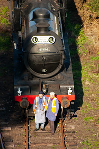 Fraser Birrell and John Cameron stand in front of 61994. The loco carries a replica headboard of the Whitby Moors railtour which ran 40 years ago this weekend using the same two locos over part of the same route. This is why 61994 has a bell on the front.