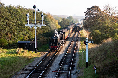 Ex LNER 4-6-0 B1 61264 passes the very impressive former NER lower quadrant slotted signal gantry with a Grosmont bound working, 2G14 1520 off Pickering. It will run into the up platform to cross 75029.
