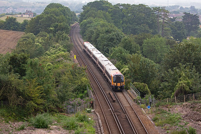 On the serious climb is 444005 a few miles into its journey to London with 1W26 1603 off Weymouth to Waterloo.  The Great Western Railway was the first to reach Weymouth in 1857 via Castle Carey and Yeovil Pen Mill.  The London and South Western Rail later made a junction with the GWR at Dorchester.