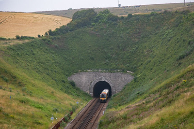 Moving now to above No 2 tunnel on the old road now a cycle path after the road was diverted over the hill above the railway.  444030 exits the 819 yard long Bincombe North or No 1 tunnel with 1W67 1305 Waterloo to Weymouth.