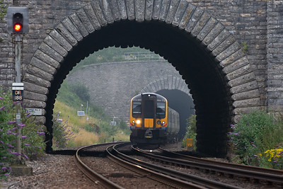 A down service formed by 444005 clears the 819 yard long tunnel and will quickly pass through the 48 yard long short tunnel.