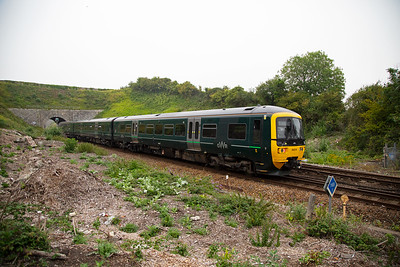 Something different as GWR liveried class 166 Networker Turbo Express unit 166216 growls past.  The platforms of Upwey Wishing Well halt stood either side of the line here.  Now it is used for dumping rubbish.  This working is 2E26 1508 off Weymouth for Cam and Dursley near Stroud in Gloucestershire.