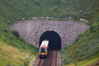 The inky blackness of Bincombe No 1 tunnel, reputed to be haunted, shallows up 444005.  The summit of the climb is just beyond the north portal.