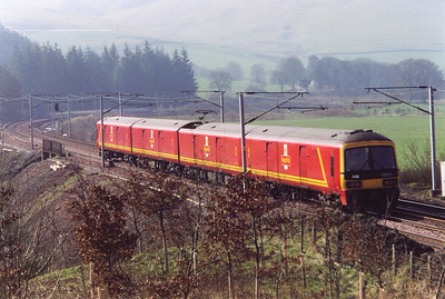 Royal Mail owned clas 325 electric unit 325010 speeds by with 5M89 1118 Motherwell TMD to Warrington RMT.