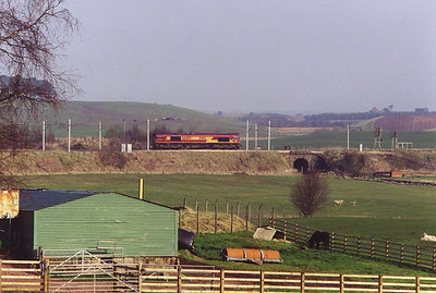 66099 runs a short distance along the Edinburgh branch as it runs round its train, 4Z30 Mossend to Law Junction empty vans.