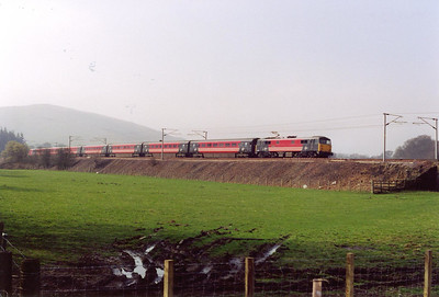A Virgin West Coast service hurries north with 87012 in charge of 1S47 0625 Euston to Glasgow Central.