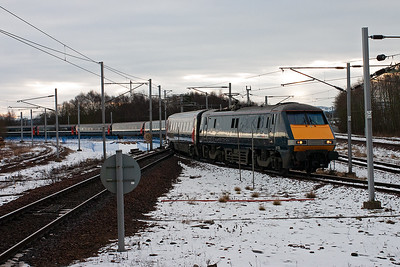 National Express 91125 brings its train off the Edinburgh branch and over onto the down main line.  This service is 1S01 0625 Newcastle to Glasgow Central.