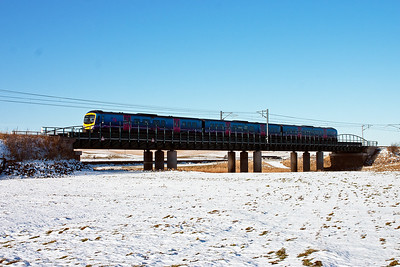 Having been held at signals at Carstairs East Junction, First Group Trans Pennine Desiro 185140 gains speed and passes over Float Viaduct with an Edinburgh to Manchester Airport service, 1M93 0955 off.