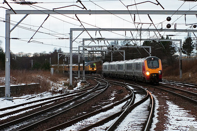 A Virgin West Coast class 221 Super Voyager, 221117, approaches a dull Carstairs station with 1M51 0800 Glasgow Central to Birmingham New Street. Parked up in the up passenger loop is 1Q26 the Network Rail Measurement Train with powercars 43013 and 43014.