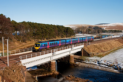 First Trans Pennine Desiro 185137 hammers south with the 1410 from Glasgow to Preston. There it will join another set from Lancaster and together they will continue to Manchester Airport