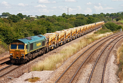 Freight action now and 66612 slowly approaches the junction with the heavy 6A75 1300 Westbury Virtual Quarry to Taunton engineers working. This is the High Output Ballast Cleaner train.