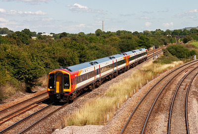 A pair of South West Trains class 159 units, 159021 and 159011, departs Westbury and heads west with an unknown working.