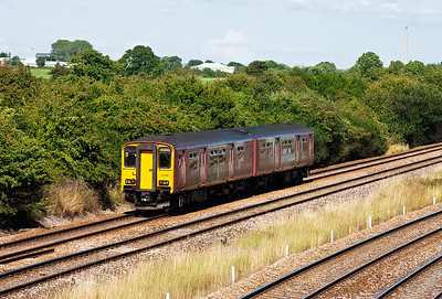 This liveried sprinter is more common to this part of the world, 150263 heads for the station at Westbury. From there it will go left at Hawkeridge and run via Bath and Bristol and the Severn Tunnel to its destination of Cardiff Central. The service is 2V83 off Weymouth.  EDIT PHOTO DETAILS
