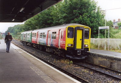 A colourful livery of views from the Welsh Valleys adorns 150279 as it slows for its Dorchester West stop. The train is 2V74 1040 Weymouth to Westbury.  3/8/2002