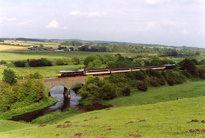 In evening sunhsine 31190 and 31459 head away from Dorchester and crossing over the River Frome. The train is 2Z88 1620 SO Weymouth to Westbury.  10/8/2002