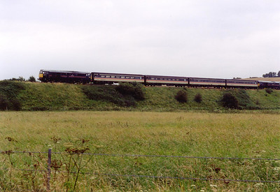 On a different day 31454 and 128 approach the southern outskirts of Dorchester with 2V74 1100 off Weymouth to Bristol.  5/7/2004