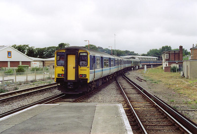 A five vehicle train consisting of two class 150 and a single class 153 sprinters depart Weymouth. 153380, 150230, 150240 form 2V79 1154 Weymouth to Bristol.  27/7/2002