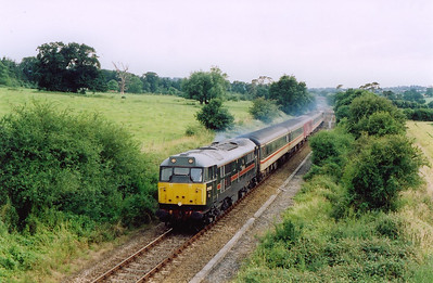 This location is near to Trent to the north of Yeovil. 31128 thrashes away  leading 2V89 1718 from the coastal town to Bristol.  13/7/2004