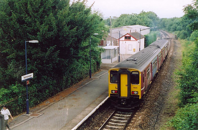 Yetminster is the location for 150251 making its station stop with 2V79 1258 from Weymouth to Bristol. This was once a double track station and the down platform is still in place and covered by vegetation.  13/7/2004