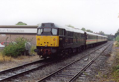 The train is booked to stand at Dorchester West for about ten minutes giving me plenty of time to change platform and the rain to come on.  The train gets the road and departs heading for Weymouth with 31190 on the rear.  3/8/2002