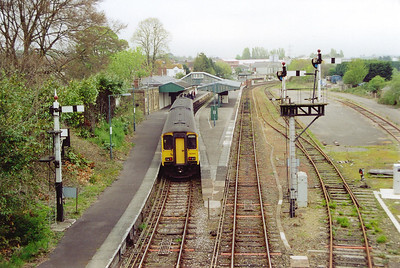 A view obtained from the road bridge at Yeovil Pen Mill sees 150266 enter the station with 2V74 1102 Weymouth to Bristol. This delightful station has former Western Region lower quadrant semaphore signals.  22/4/2002