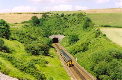 A hot sunny afternoon and 158817 approaches Bincombe Tunnel between Weymouth and Dorchester. The train is 2V83 1456 from Weymouth to Bristol.  5/7/2004