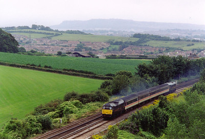 A classic location on Bincombe Bank on the 1 in 50 climb from Weymouth to the north end of Bincombe Tunnel. 31602 leads the ascent with 2Z88 1620 SO off Weymouth to Westbury.  27/7/2002