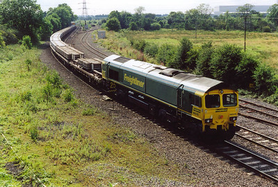 On the back of the P Way train is Freightliner 66515. The majority of the train was formed of concrete sleepers.
