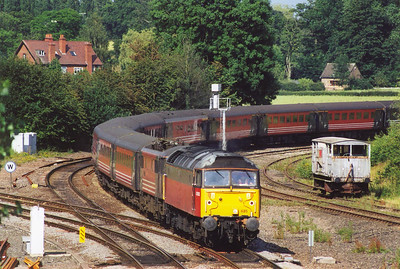 47635 is seen yet again on its fifth different working. It leads 87023 and 1G31 SuO 1440 off Euston to Wolverhampton. The line trailing in from the left leads to Burton upon Trent.