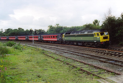 "The second of two booked class 47 workings approaches with what turned out to be the last loco hauled Cross Country working I would see. The rumour amongst the gathered photographers was rife that ""celebrity"" two tone green D1648 would be working 1M87 SuO 0935 Penzance to Manchester Piccadilly."